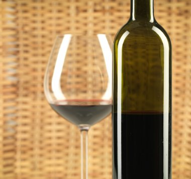 Bottle and glass of wine wicker background