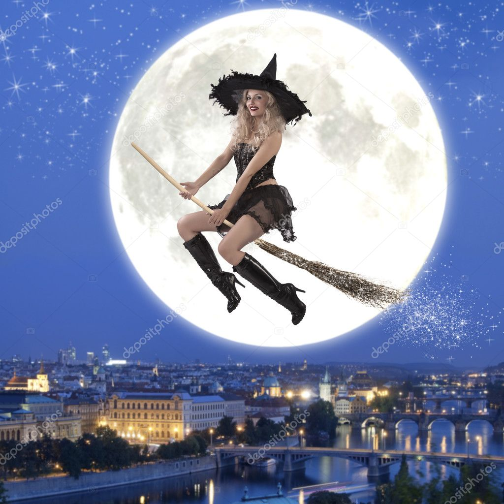 Sexy witch riding a broom