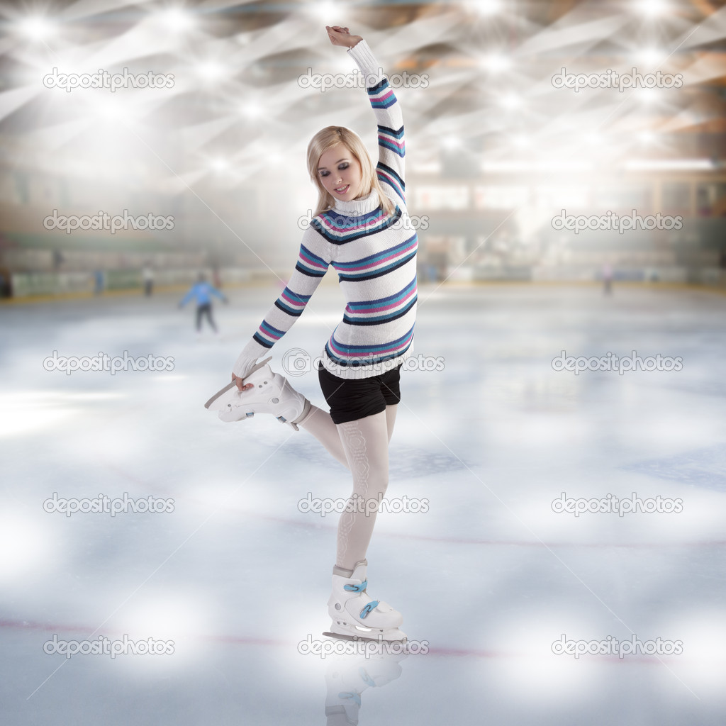 Young beautiful woman ice skating