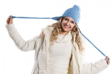 Blue hat on a blond girl, playing with the hat's braids