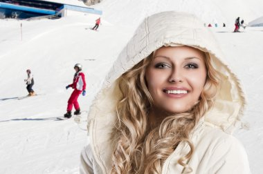 Girl with white hood, she's cold, foreground beautiful smile