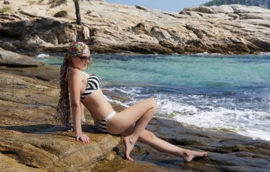 Attractive girl relaxing on the sea.
