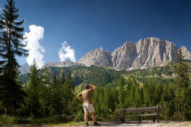 Man admiring a breathtaking mountain/alpine scenery
