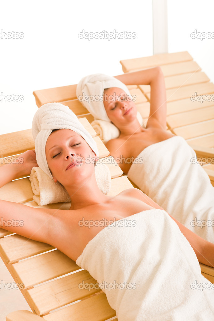Beauty Spa Room Two Women Relax Sun Beds Stock Photo