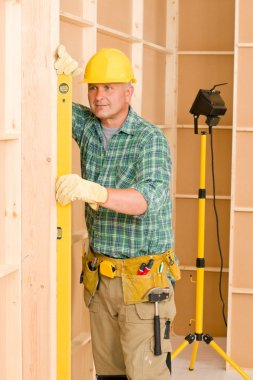 Handyman mature professional with spirit level