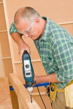 Handyman home improvement drilling wood