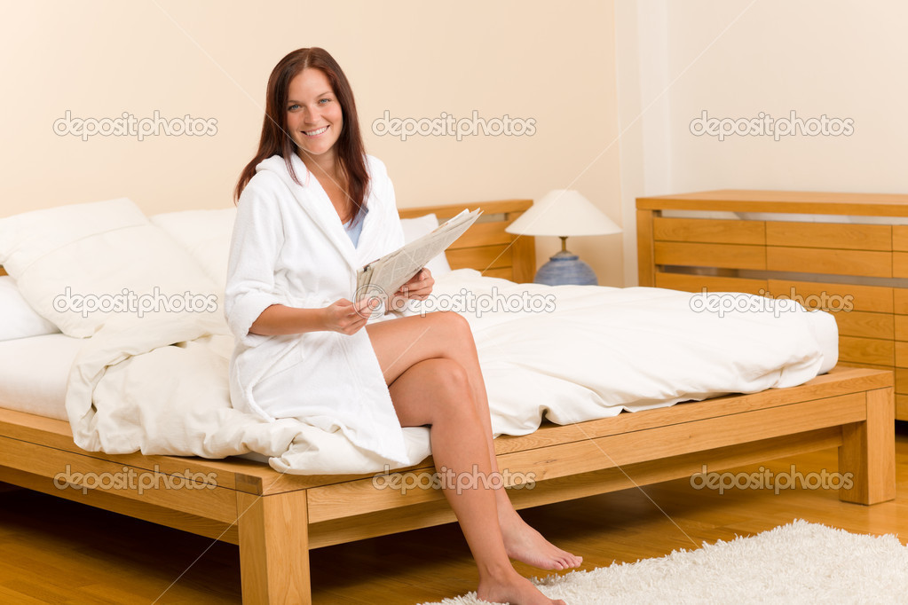 Blonde mature on hotel bed