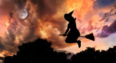 Flying witch on broomstick