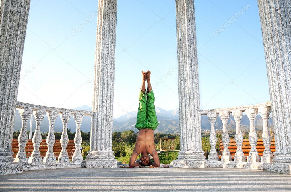 Yoga head stand lotus pose