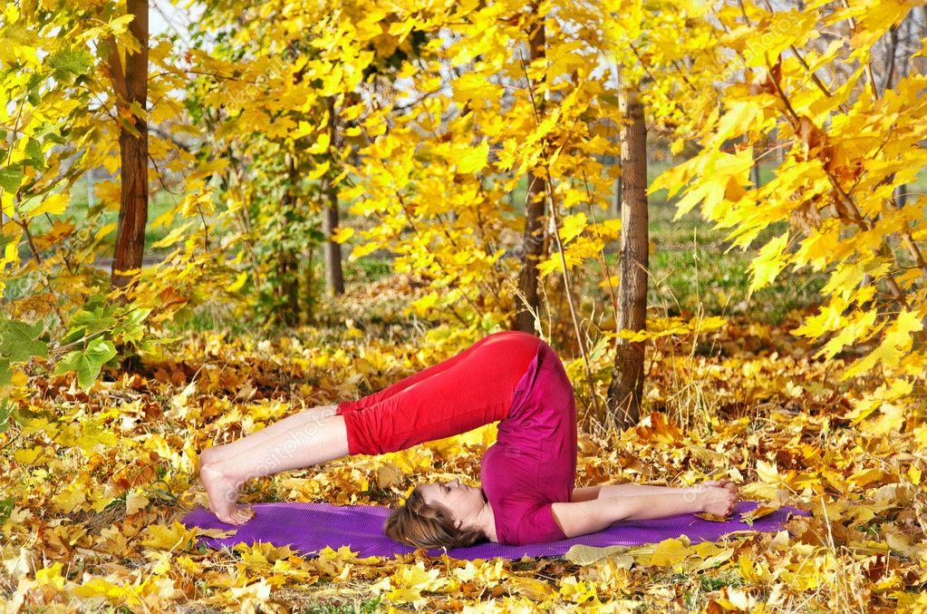 Yoga halasana in autumn