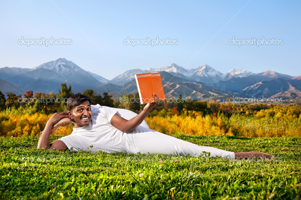Yoga man reading the book
