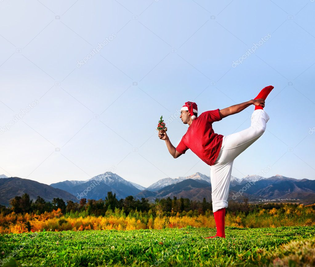 Christmas yoga dancer pose