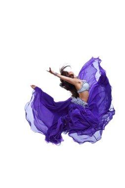 Young girl jump in purple oriental eastern veil