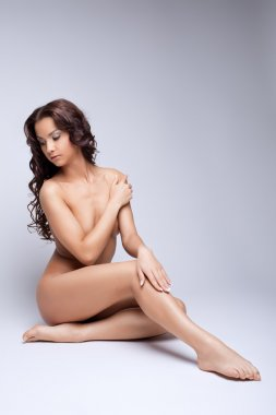 Cute nude girl posing naked for art photography