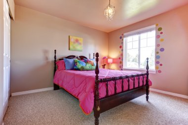 Pink girls bedroom with cute bed