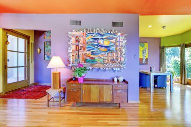 Retro bright living room with purple wall