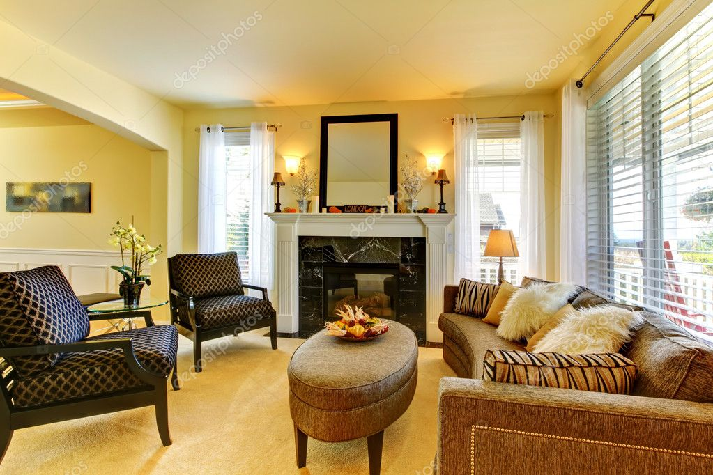 Golden Living Room : Living room in golden yellow wth fireplace and mirror ...