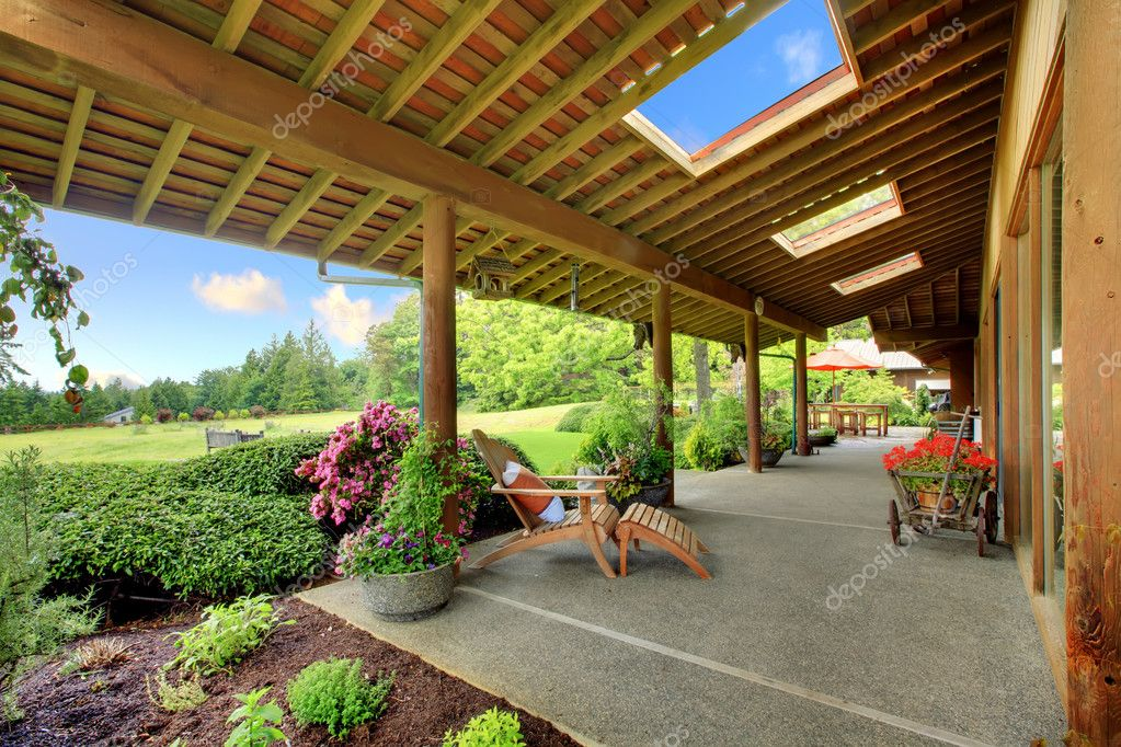 Large ranch covered porch with flowers