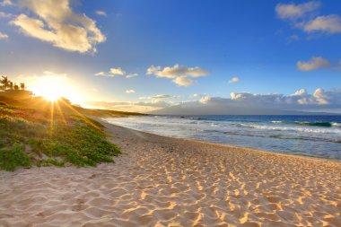 Tropical beach sunset at Oneloa Beach, Maui, Hawaii