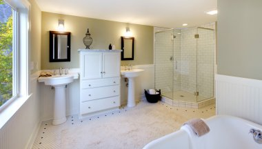 Luxury bathroom with tub and modern shower and double sink