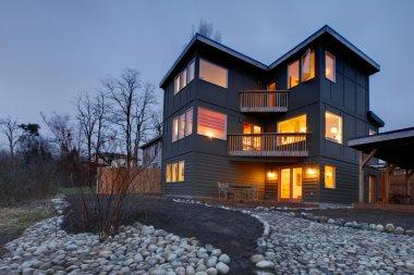 Exterior modern large grey house at night
