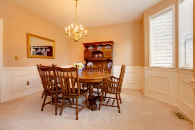 Elegant dining room with wood table and chairs.