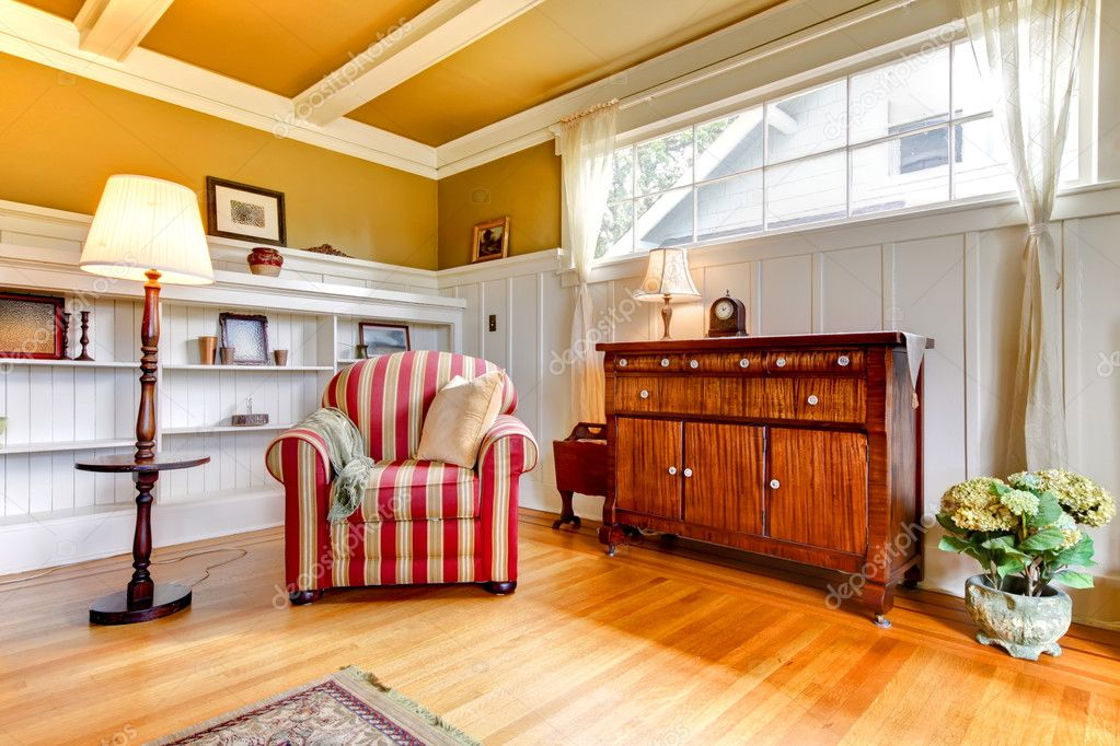 Living Room With Red Chair And Gold Ceiling And Walls  Stock - Golden living room