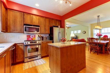 Red modern new kitchen with beautiful wood.