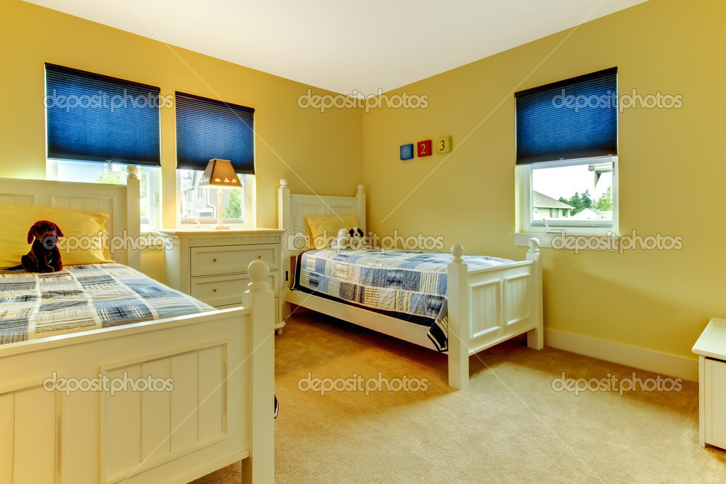 Kids yellow and blue bedroom with two single beds. — Stock Photo ...
