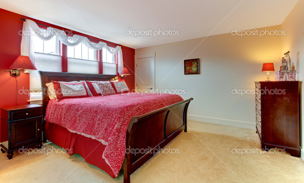 Master Red Bedroom With Beige Carpet Stock Photo