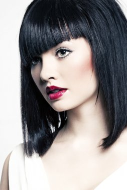 Beautiful girl with perfect skin, red lipstick and black hair on white back