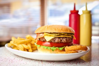 Fresh hamburger with french fries.