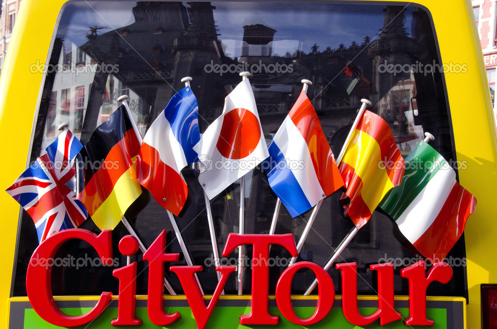 City tour bus for tourists detail with flags
