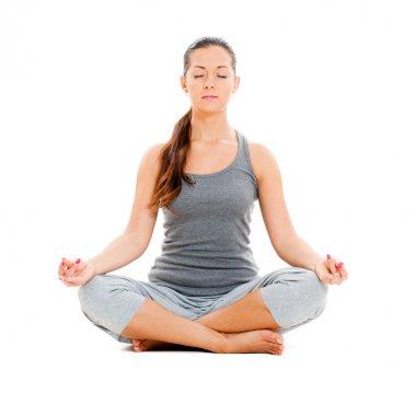 Pretty woman doing yoga exercise