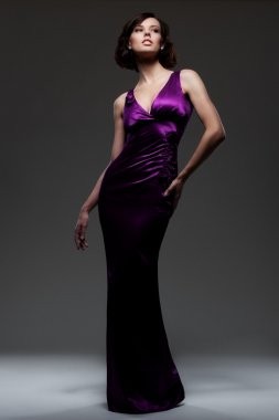 Alluring sexy woman in evening dress