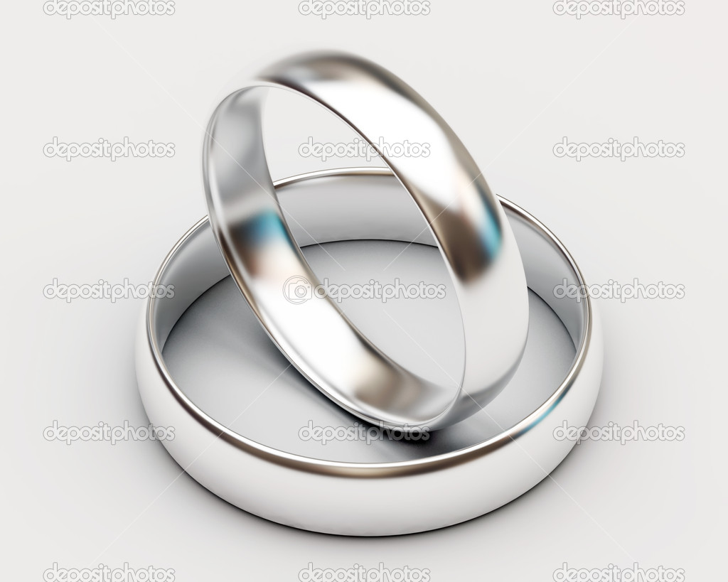 Platinum Wedding Rings On White Background Stock Photo
