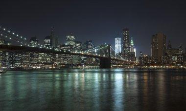 The New York City skyline w Brooklyn Bridge and Freedom tower