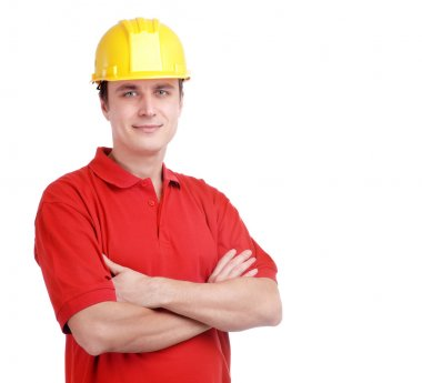 Young builder in yellow helmet isolated on white