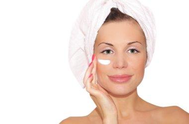 Beautiful woman applying mask