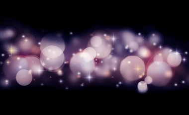Abstract holiday background of glowing bokeh lights