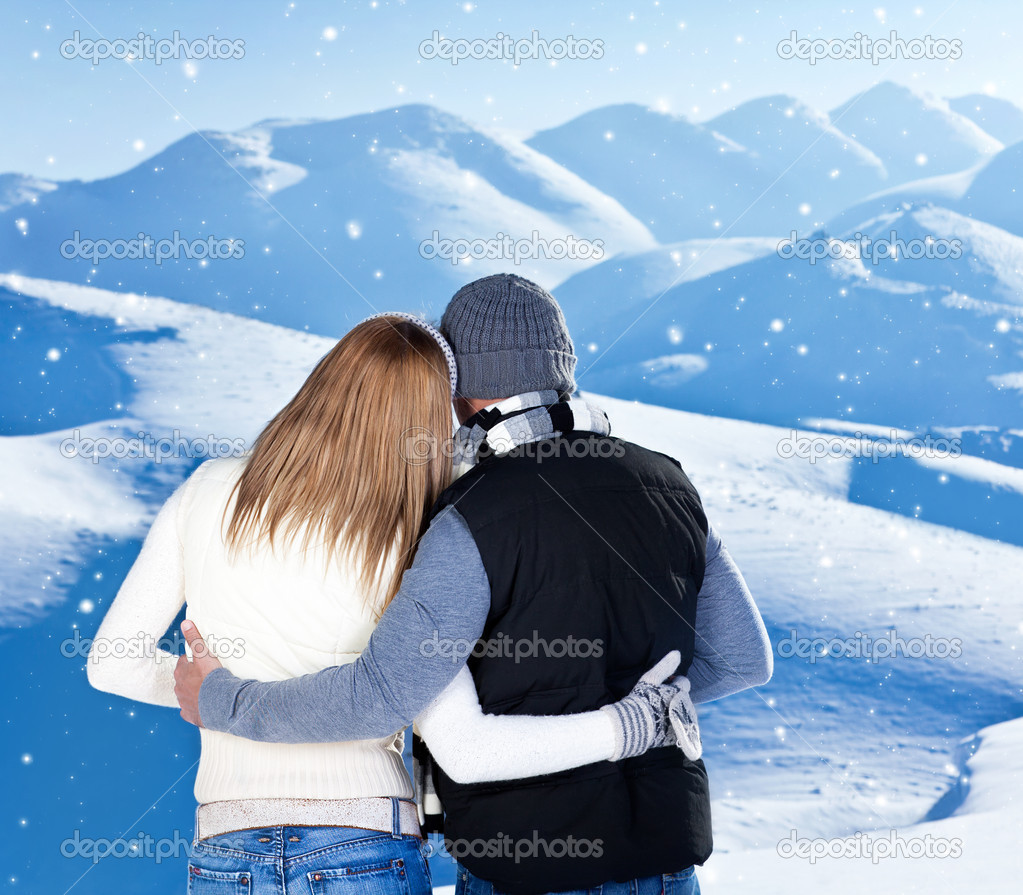 Happy Couple Hugging Outdoor At Winter Mountains, Rear