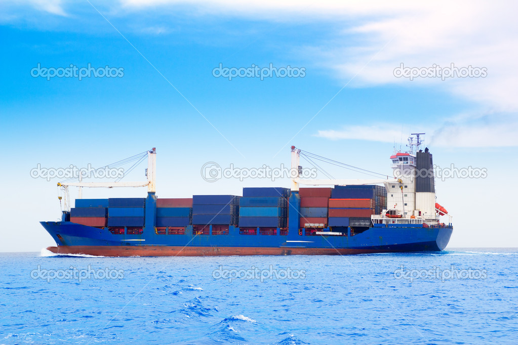 Cargo ship with containers in dep blue sea