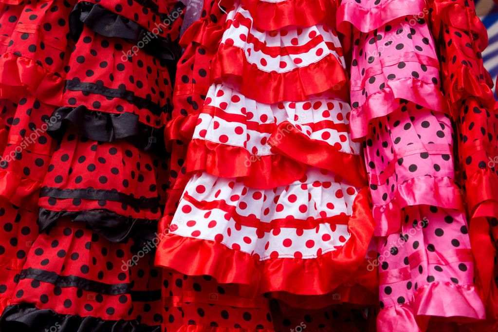 Red pink gipsy costumes of flamenco dancer