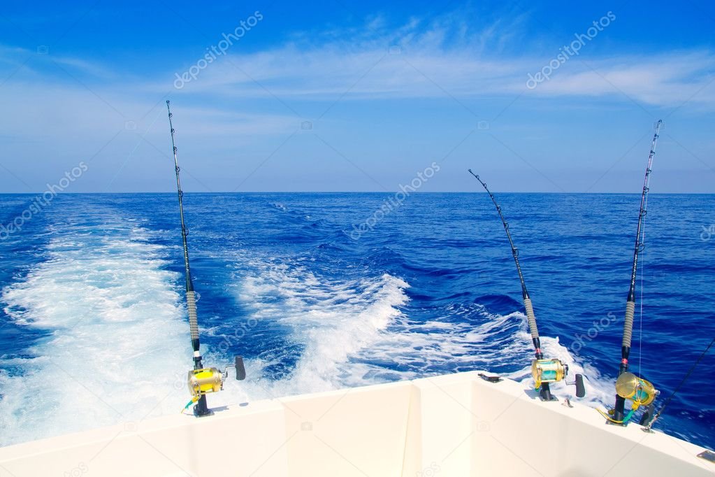 Boat fishing trolling in deep blue sea