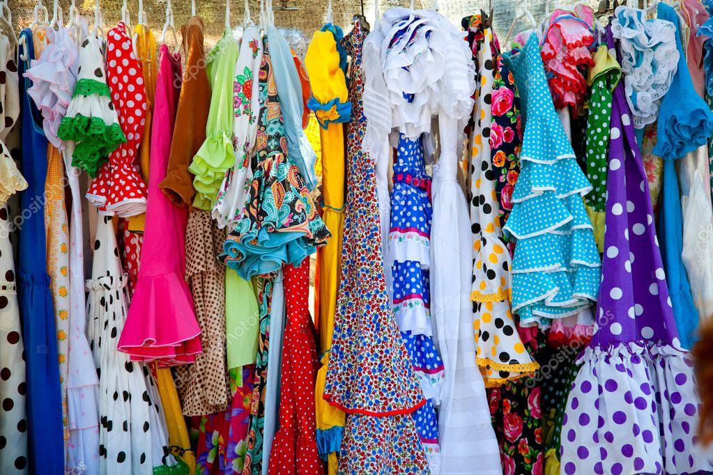 Colorful gipsy dresses in rack hanged in Spain