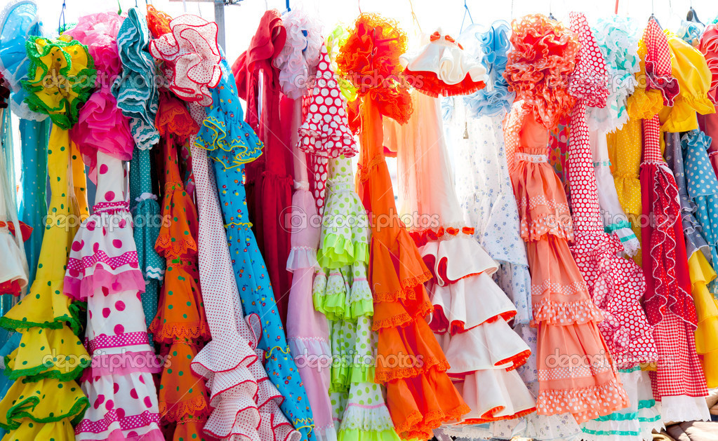 Colorful gipsy dresses in rack hanged in Spain