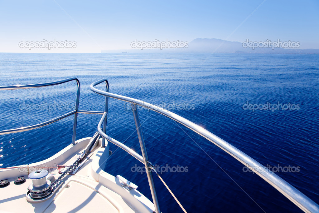 Boat bow sailing in blue Mediterranean sea