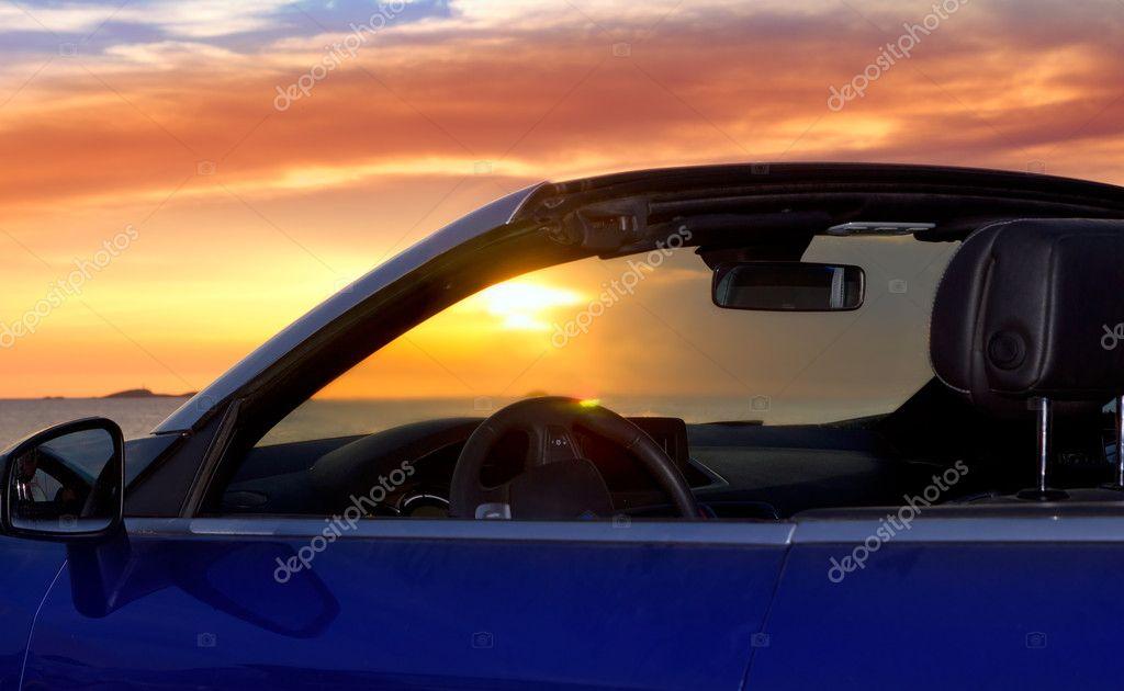 Ibiza sunset in Cala Conta from convertible