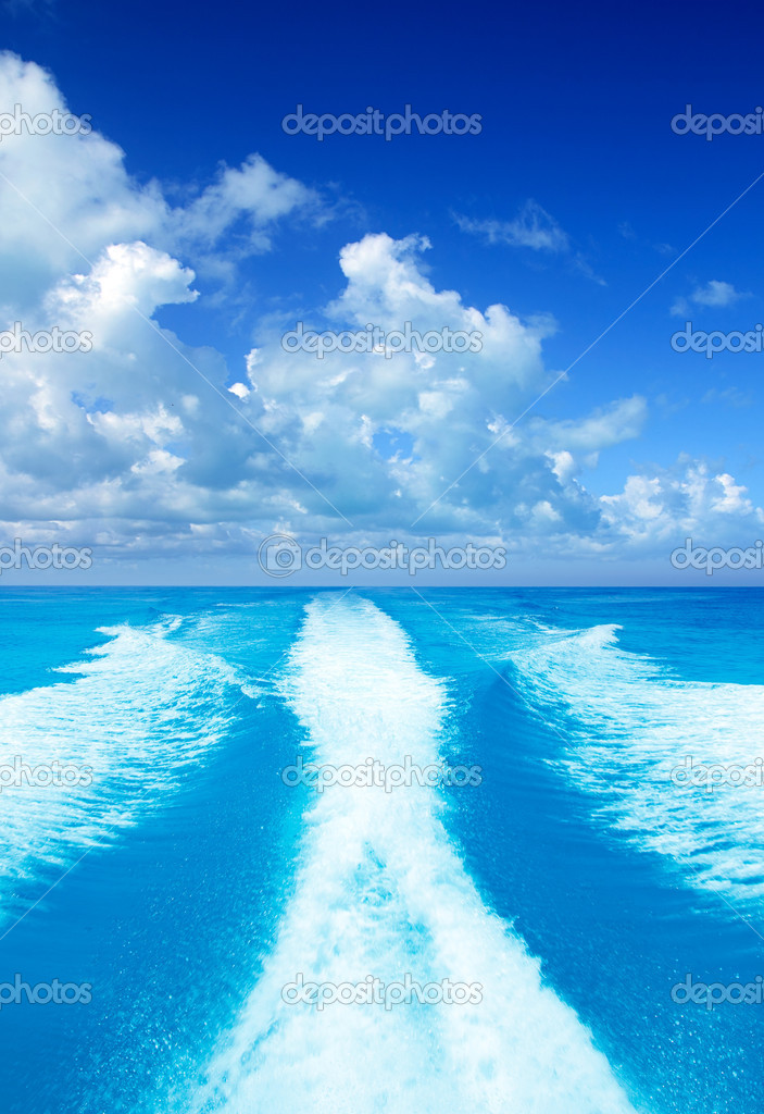 Boat wake prop wash on turquoise sea