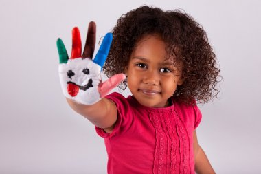 Little African Asian girl with painted hands